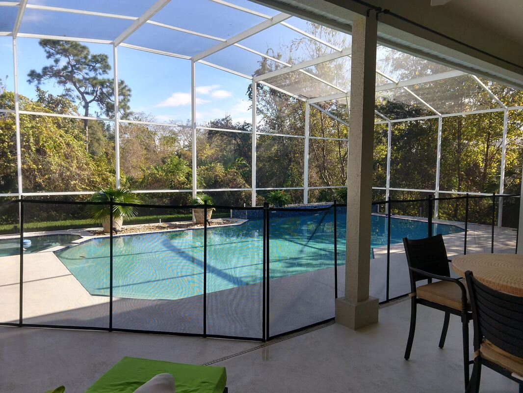 another picture of a properly installed pool fence by premier pool fence at apopka home in an enclosed pool cage area.