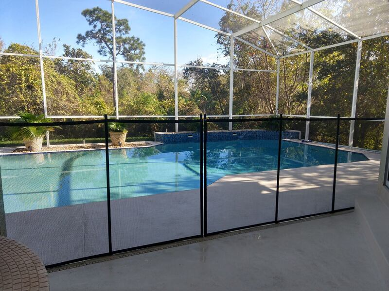 picture of a pool safety fence installed into a pool cool deck at a home in oviedo.