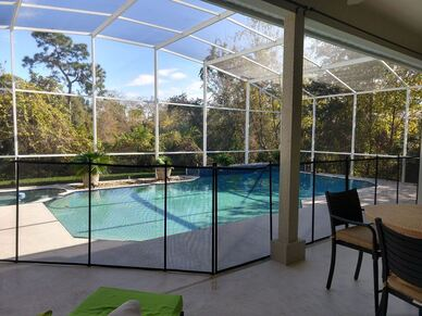 another picture of a properly installed pool fence by premier pool fence at kissimmee home in an enclosed pool cage area.